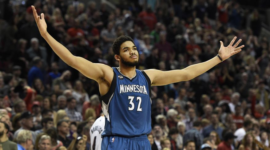 FILE - In this April 9, 2016, file photo, Minnesota Timberwolves center Karl-Anthony Towns celebrates after hitting the game-winning shot in an NBA basketball game against the Portland Trail Blazers in Portland, Ore. Towns is the unanimous winner of the NBA Rookie of the Year award. The league made the announcement Monday, May 16, 2016, giving the Wolves back-to-back honorees.  (AP Photo/Steve Dykes, File)