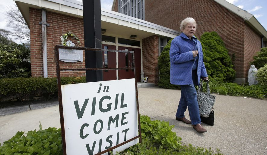Margaret O'Brien, a parishioner at the church of St. Frances X. Cabrini, departs the church Monday, May 16, 2016, in Scituate, Mass. The Supreme Court has refused to hear an appeal from parishioners who are occupying the church, which the Roman Catholic Archdiocese of Boston closed more than a decade ago. (AP Photo/Steven Senne)
