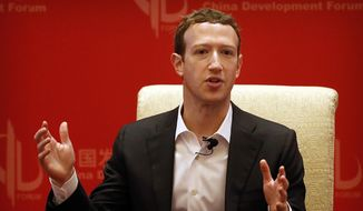 Facebook CEO Mark Zuckerberg speaks during a panel discussion held as part of the China Development Forum at the Diaoyutai State Guesthouse in Beijing, in this Saturday, March 19, 2016, file photo. (AP Photo/Mark Schiefelbein, File)