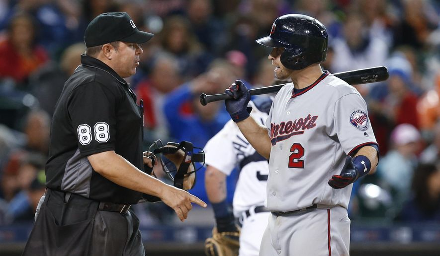 Minnesota Twins' Brian Dozier (2) reacts to a called third strike by umpire Doug Eddings (88) in the seventh inning of a baseball game against the Detroit Tigers, Monday, May 16, 2016 in Detroit. (AP Photo/Paul Sancya)