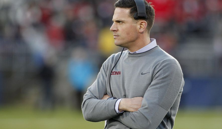 FILE - This Nov. 21, 2015 photo shows Connecticut head coach Bob Diaco during the first quarter of an NCAA college football game against Houston in East Hartford, Conn. Diaco has agreed to a two-year contract extension designed to keep him in Storrs through the 2020 football season, the school said Monday, May 16, 2016. (AP Photo/Stew Milne)