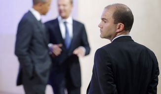 Deputy National Security Adviser for strategic communications Ben Rhodes stands at right as President Obama and Polish Prime Minister Donald Tusk leave the stage after making statements to reporters in Warsaw on June 3, 2014. (Associated Press) **FILE**