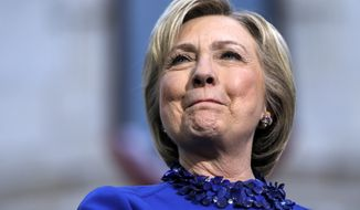Democratic presidential candidate Hillary Clinton smiles during a campaign stop at City Hall in Philadelphia on April 25, 2016. (Associated Press) **FILE**