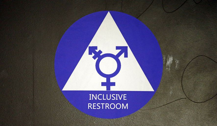 A new sticker designates a gender neutral bathroom at Nathan Hale high school Tuesday, May 17, 2016, in Seattle. President Obama's directive ordering schools to accommodate transgender students has been controversial in some places but since 2012 Seattle has mandated that transgender students be able to use of the bathrooms and locker rooms of their choice. Nearly half of the district's 15 high schools already have gender neutral bathrooms and one high school has had a transgender bathroom for 20 years. (AP Photo/Elaine Thompson)