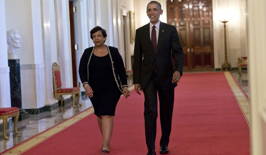 President Barack Obama and Attorney General Loretta Lynch arrive for a Medal of Valor ceremony in the East Room of the White House in Washington, Monday, May 16, 2016. The Medal of Valor is awarded to public safety officers who have exhibited exceptional courage, regardless of personal safety, in the attempt to save or protect others from harm.(AP Photo/Carolyn Kaster)