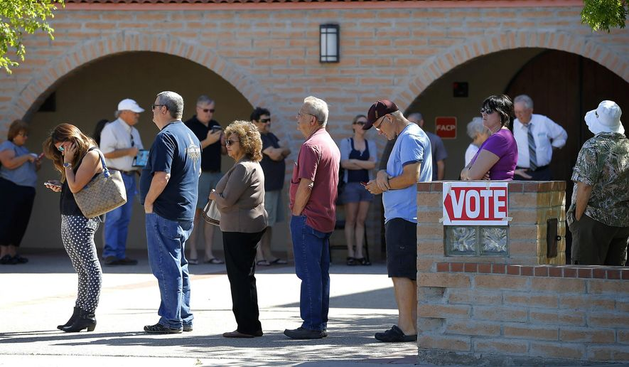 FILE - In this March 22, 2016 file photo, voters wait in line to cast their ballot in Arizona's presidential primary election in Gilbert, Ariz. Voters across Arizona head to the polls Tuesday, May 17, 2016, to decide the fate of education funding and pension overhaul measures at a special election. The election will also test whether efforts Maricopa County took to avoid a repeat of the long lines seen during the March presidential primary worked. (AP Photo/Matt York, File)