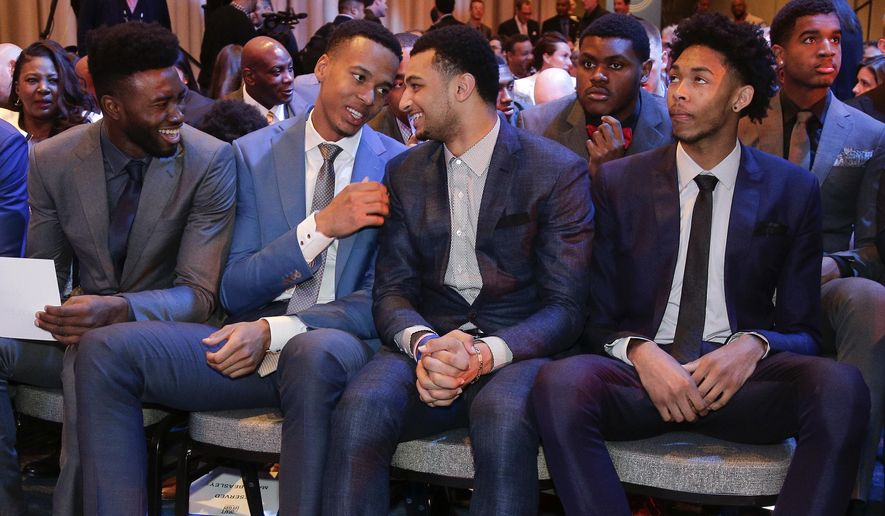 From left, NBA draft prospects Jaylen Brown, Skal Labissiere, Jamal Murray and Brandon Ingram talk before the start of the NBA basketball draft lottery, Tuesday, May 17, 2016, in New York. (AP Photo/Julie Jacobson)