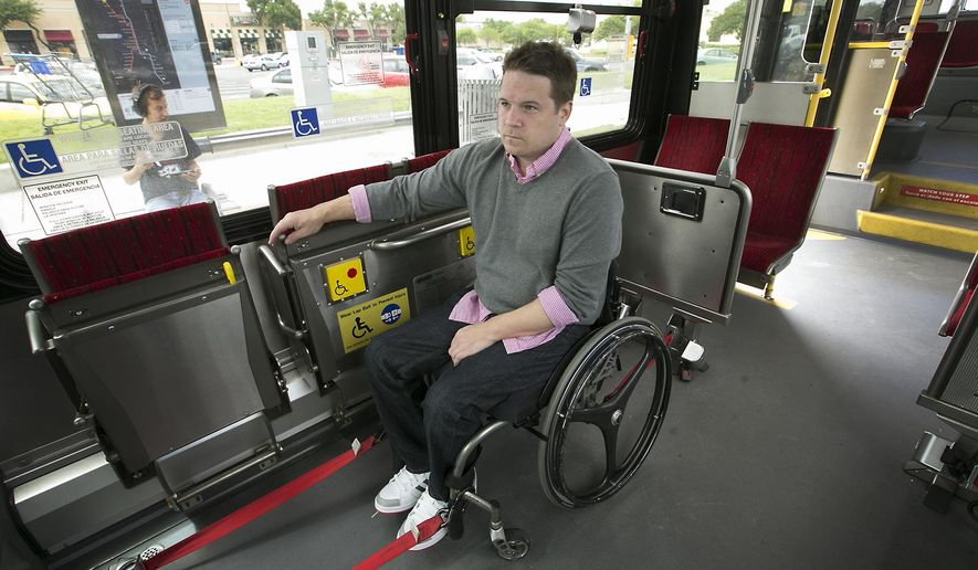 In this Monday, May 16, 2016 photo, Boone Blocker, who has to use an alternative form of transportation like Capital Metro to get around town now that Uber and Lyft have left, waits on a MetroRapid bus near Northcross Mall for a trip to City Hall in downtown Austin, Texas.  (Ralph Barrera /Austin American-Statesman via AP)  AUSTIN CHRONICLE OUT, COMMUNITY IMPACT OUT, INTERNET AND TV MUST CREDIT PHOTOGRAPHER AND STATESMAN.COM, MAGS OUT; MANDATORY CREDIT
