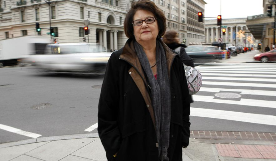FILE - This Tuesday, Dec. 8, 2009 picture shows Elouise Cobell outside the law offices of Kilpatrick & Stockton in Washington. U.S. officials are adding 63 American Indian reservations across the Midwest and West to an initiative that seeks to return millions of acres of land to tribal ownership. it's the result of a legal settlement with American Indians led by Cobell of Montana, who said the U.S. mismanaged trust money held on behalf of hundreds of thousands of Indians. (AP Photo/Gerald Herbert,File)