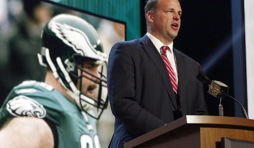 FILE - In this May 1, 2015, file photo, former NFL tackle and congressman Jon Runyan  announces that the Philadelphia Eagles selects Utah defensive back Eric Rowe as the 47th pick in the second round of the 2015 NFL Football Draft in Chicago. Runyan has been hired as vice president of policy and rules administration, the league said on Tuesday, May 17, 2016.  (AP Photo/Charles Rex Arbogast, File)