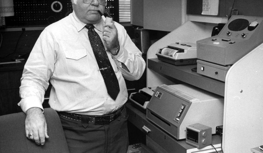 FILE - This Feb. 15, 1985 file photo shows former AP photographer Ed Kolenovsky transmitting photos at the bureau office in Houston.  Kolenovsky, who for some 40 years chronicled development of the nation's space program, covered countless Gulf Coast hurricanes and travelled the world taking photos of championship fights and other sports for the AP, has died, Tuesday, May 17, 2016. He was 87.(AP Photo, File)