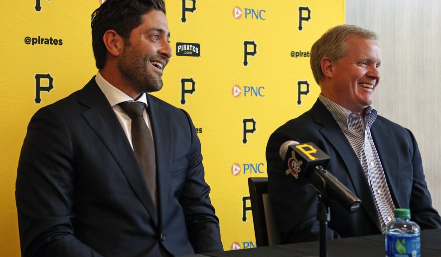 Pittsburgh Pirates catcher Francisco Cervelli, left, and Pirates general manager Neil Huntington meet with the media in Pittsburgh, Tuesday, May 17, 2016, after agreeing to a three-year baseball contract extension that will make keep Cervelli with the Pirates through the 2019 season. (AP Photo/Gene J. Puskar)