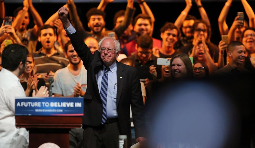 Democratic presidential candidate Sen. Bernie Sanders, I-Vt., greets students at the University of Puerto Rico Theater in San Juan, Puerto Rico, Monday, May 16, 2016. Sanders arrived in Puerto Rico on Monday to talk about the U.S. territory's worsening debt crisis ahead of the June 5 primary. (Eric Rojas/El Vocero via AP) MANDATORY CREDIT - PUERTO RICO OUT - NO PUBLICAR EN PUERTO RICO