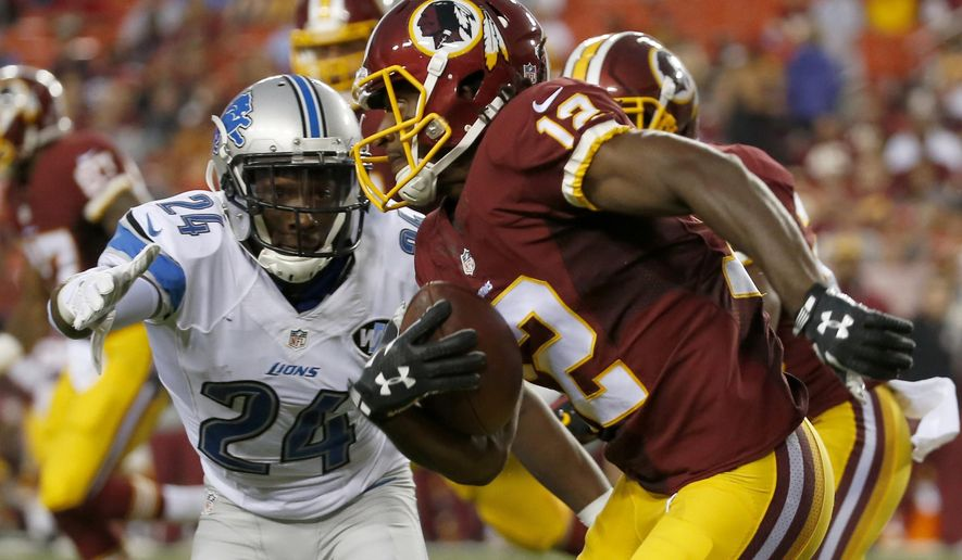 In this photo taken Aug. 20, 2015, Washington Redskins wide receiver Andre Roberts (12) runs past Detroit Lions cornerback Nevin Lawson (24) during the first half of an NFL preseason football game in Landover, Md. The Washington Redskins have released wide receiver Roberts.  (AP Photo/Alex Brandon)