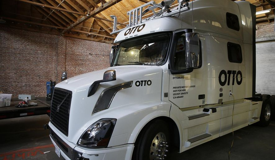 This Thursday, May 12, 2016, photo shows an Otto driverless truck at a garage in San Francisco. An 18-wheel truck barreling down the highway with 80,000 pounds of cargo and no one behind the wheel might seem reckless to most people, even in an age when a few driverless cars already are cruising some city streets. But robot-loving Anthony Levandowski is betting autonomous big rigs will be the next big thing on the road to creating a safer and saner transportation system. (AP Photo/Eric Risberg)