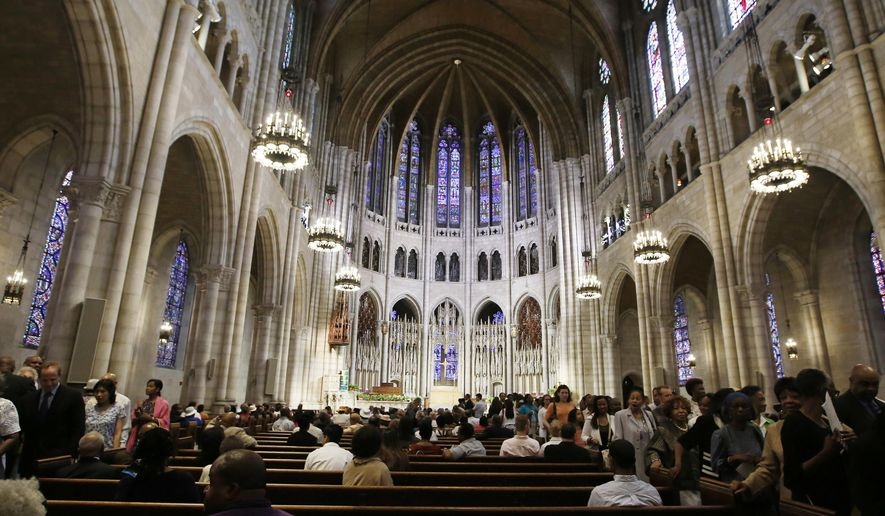 """FILE- This July 20, 2014, file photo shows the vaulted ceiling inside New York's Riverside Church. It is one of the religious institutions across New York state showcasing their art, architecture and history during the New York Landmark Conservancy's annual """"Sacred Sites Open House Weekend"""" from May 21-22, 2016. (AP Photo/Kathy Willens, File)"""