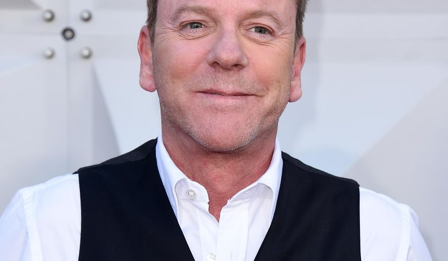 FILE - In this April 3, 2016 file photo, Kiefer Sutherland arrives at the 51st annual Academy of Country Music Awards in Las Vegas. Sutherland will play a low-level Cabinet member who suddenly becomes president on a new ABC drama this fall, one of nine new series the network will launch next season. (Photo by Jordan Strauss/Invision/AP, File)