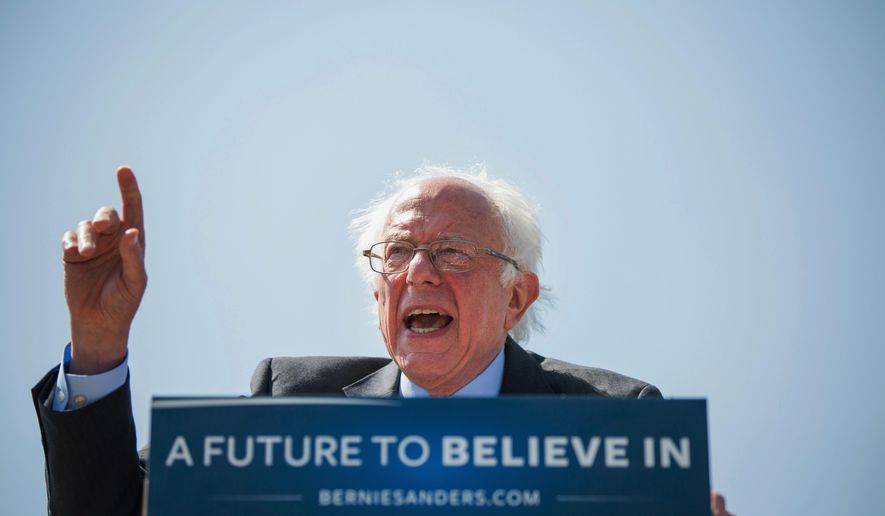 """Rage: """"I say to the leadership of the Democratic Party: Open the doors, let the people in,"""" presidential candidate Bernard Sanders said at a rally Tuesday. (Associated Press)"""