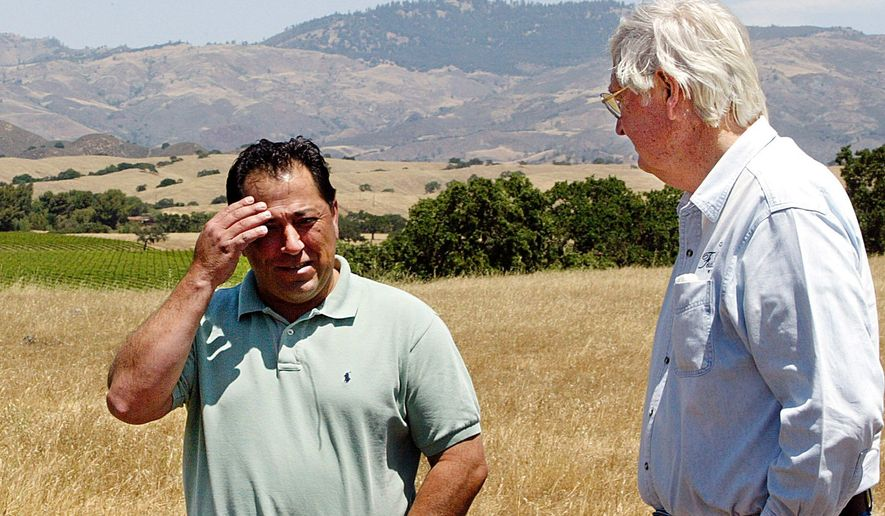 Fess Parker (right) talks with Vincent Armenta, chairman of the Santa Ynez Band of Chumash Indians. The tribe's purchase of Parker's land set off a bitter dispute. (Associated Press)