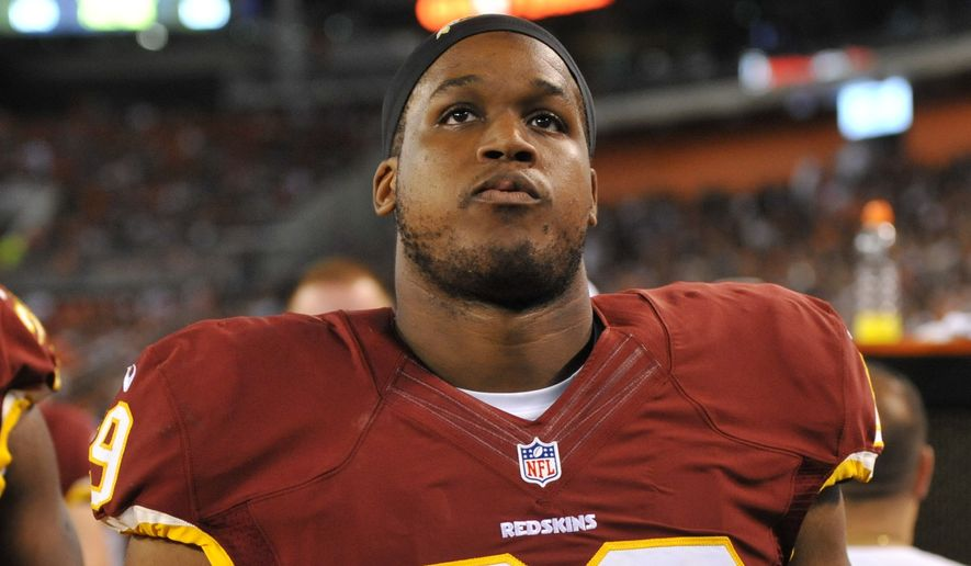 Washington Redskins offensive tackle Takoby Cofield stands on the sideline during an NFL preseason football game against the Cleveland Browns Thursday, Aug. 13, 2015, in Cleveland. Washington won 20-17. (AP Photo/David Richard)