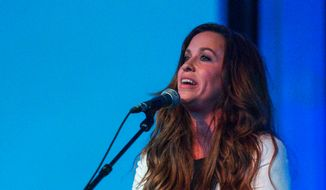 Alanis Morissette performs on stage during the 6th Annual ELLE Women In Music Celebration Presented By eBay at Boulevard3 on Wednesday, May 20, 2015 in Los Angeles. (Photo by Paul A. Hebert/Invision/AP)