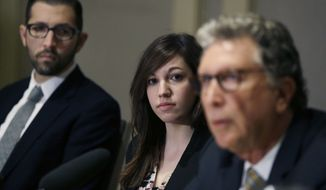 Alyssa Leader, a recent Harvard graduate, listens while flanked by her attorneys Alex Zalkin, left, and Irwin Zalkin at a news conference, Wednesday, Feb. 17, 2016, in Cambridge, Mass., about the filing of a Title IX civil lawsuit on her behalf alleging the university failed to adequately protect her and investigate complaints of sexual assault, harassment and retaliation. Leader says she was sexually assaulted between March 2013 and March 2014 on campus while she was a student at Harvard. (AP Photo/Elise Amendola)