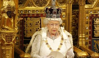 Britain's Queen Elizabeth II reads the Queen's Speech from the throne during the State Opening of Parliament in the House of Lords in London, Wednesday, May, 18, 2016. (AP Photo/Alastair Grant Pool)
