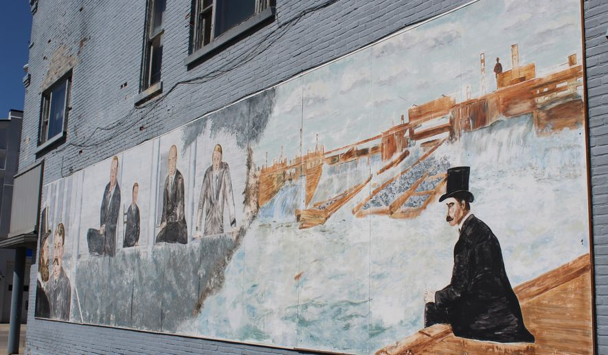 This photo taken Tuesday, May 17, 2016, shows a mural displaying some of the history of Alpena, Mich., on the side of the former Alpena Power Co. building. Plans call for the mural to be removed before the building is demolished this summer and it may be displayed at another location in Alpena. (Steve Shulwitz/The Alpena News via AP) MANDATORY CREDIT