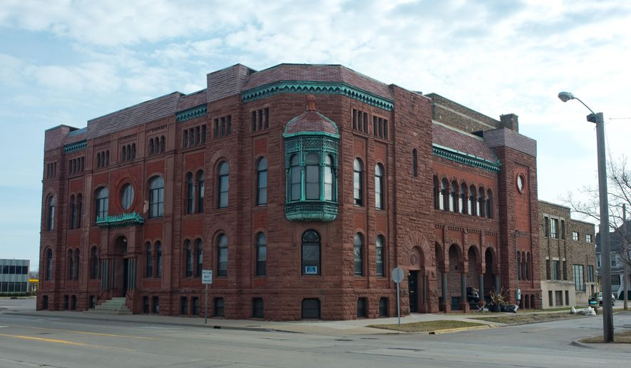 This April 12, 2016 photo shows the historic Masonic Temple in Bay City, Mich. Officials say the historic masonic temple has been included in the National Register of Historic Places. Keith Birchler, board member on the Bay Arts Council,says that the recognition raises the profile of the building. He's part of Friends of the Historic Masonic Temple and says it took the organization three years to get the designation.(Yfat Yossifor/The Bay City Times via AP) LOCAL TELEVISION OUT; LOCAL INTERNET OUT; MANDATORY CREDIT