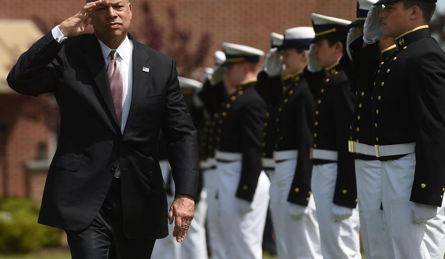 Homeland Security Secretary Jeh Johnson salutes as he passes the cadet cordon for the United States Coast Guard Academy graduation in New London, Conn., Wednesday, May 18, 2016.  Johnson gave the commencement address to the 186 members of the class of 2016.  (Dana Jensen/The Day via AP)