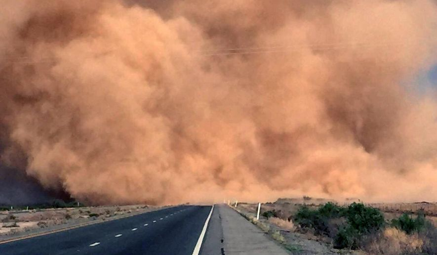 This Monday, May 16, 2016 photo, shows a dust storm on Interstate 10 near San Simon, Ariz. State officials say the owner of a farm that was cleared but not planted will face fines if the owner doesn't act to contain the soil, which is loose and easily picked up by winds. A  dry winter means the Southwest is seeing a greater number of dust storms. (Arizona Department of Public Safety via AP)