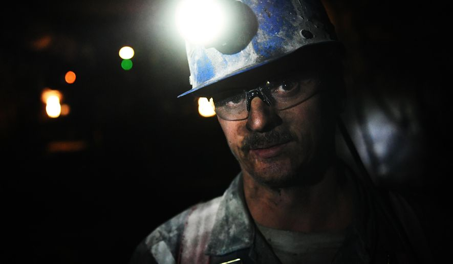 ADVANCE FOR USE SATURDAY, MAY 21 - In this photo taken April 28, 2016, Terry Hardman works underground at the West Elk Mine in Somerset, Colo. The coal mine is the last coal mine still operating in the area. Two other mines near Somerset recently closed. (RJ Sangosti/The Denver Post via AP) MAGS OUT; TV OUT; INTERNET OUT; NO SALES; NEW YORK POST OUT; NEW YORK DAILY NEWS OUT; MANDATORY CREDIT