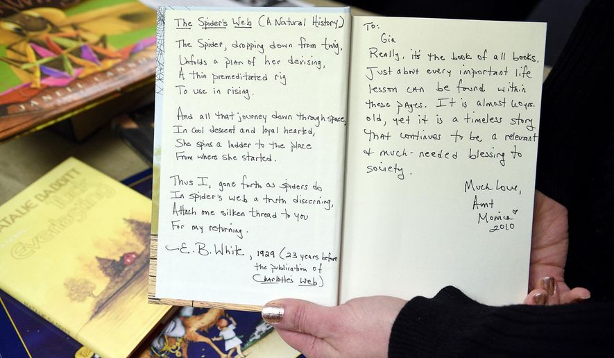 In an April 4, 2016 photo, Michele Scuro holds one of the books her sister Monica Held, inscribed to her niece Gia Scuro before Monica killed herself in August of 2010. Her family still struggles with the reality of her absence. (Celeste Van Kirk/Observer-Reporter via AP)