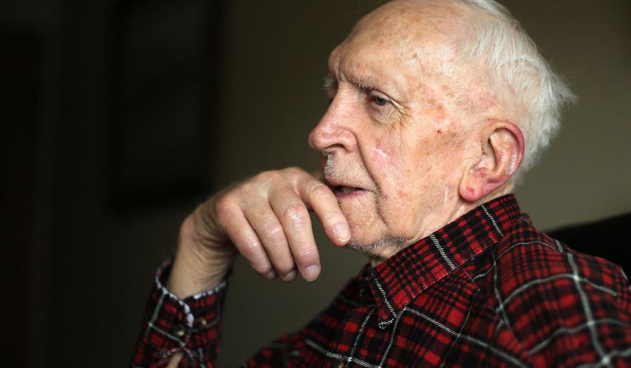 In this photo taken Monday, May 9, 2016, Chuck Kline, 93, reflects on his experiences in a U.S. Navy submarine during World War II during an interview at Primrose Retirement Community in Cheyenne, Wyo.  (Blaine McCartney/The Wyoming Tribune Eagle via AP) MANDATORY CREDIT