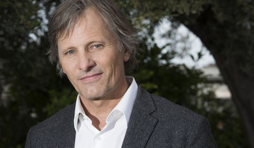 Actor Viggo Mortensen poses for portrait photographs for the film Captain Fantastic at the 69th international film festival, Cannes, southern France, Wednesday, May 18, 2016. (AP Photo/Joel Ryan)