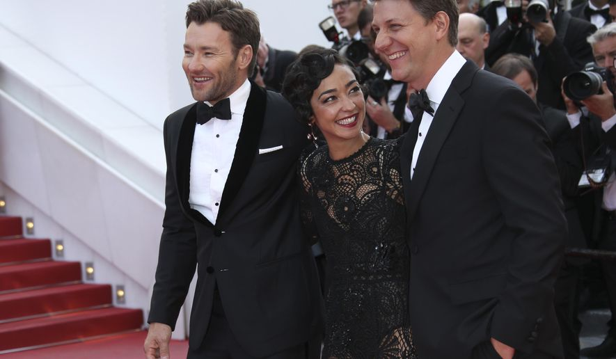 Actor Joel Edgerton, actress Ruth Negga, and director Jeff Nichols, from left, pose for photographers upon arrival at the screening of the film Loving at the 69th international film festival, Cannes, southern France, Monday, May 16, 2016.(AP Photo/Joel Ryan)