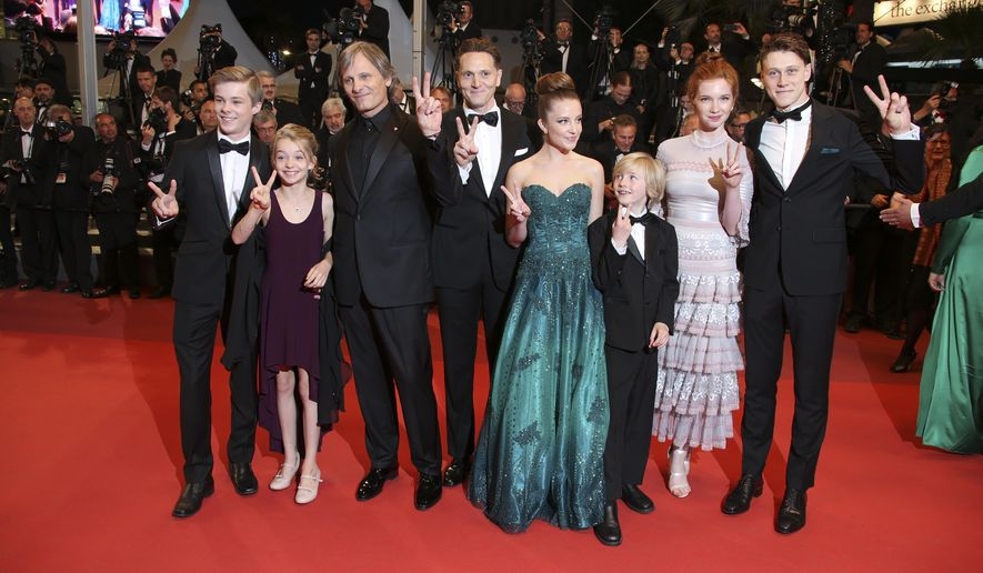 Actors Nicholas Hamilton, Shree Crooks, Viggo Mortensen, director Matt Ross, Samantha Isler, Charlie Shotwell, Annalise Basso, from left, pose for photographers upon arrival at the screening of the film Personal Shopper at the 69th international film festival, Cannes, southern France, Tuesday, May 17, 2016. (AP Photo/Joel Ryan)