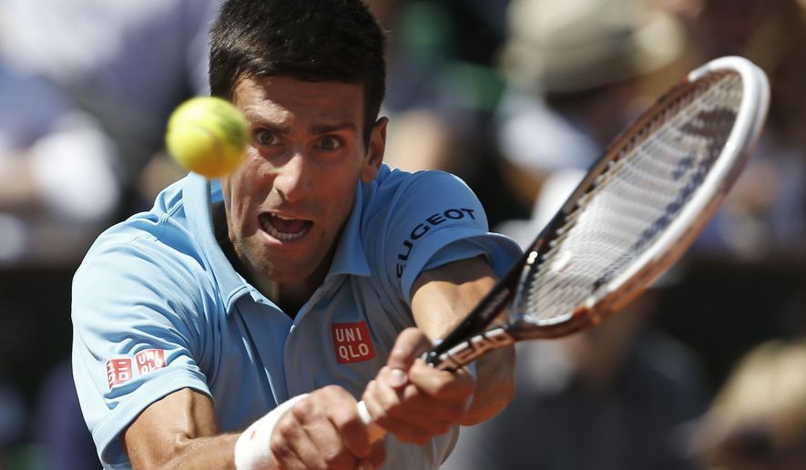 FILE - In this June 6, 2014, file photo, Serbia's Novak Djokovic returns the ball during the semifinal match of the French Open tennis tournament against Latvia's Ernests Gulbis in Paris, France. The French Open begins on Sunday, May 22, 2016. (AP Photo/Darko Vojinovic, File)
