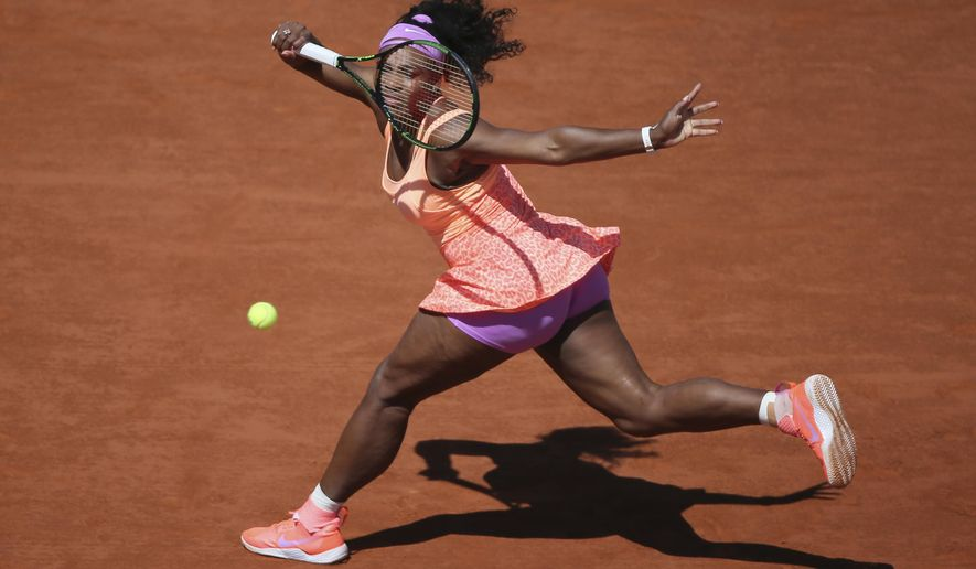 FILE - In this June 6, 2015, file photo, Serena Williams returns in the final of the French Open tennis tournament against Lucie Safarova of the Czech Republic at Roland Garros stadium, in Paris, France. The French Open begins on Sunday, May 22, 2016. (AP Photo/David Vincent, File)