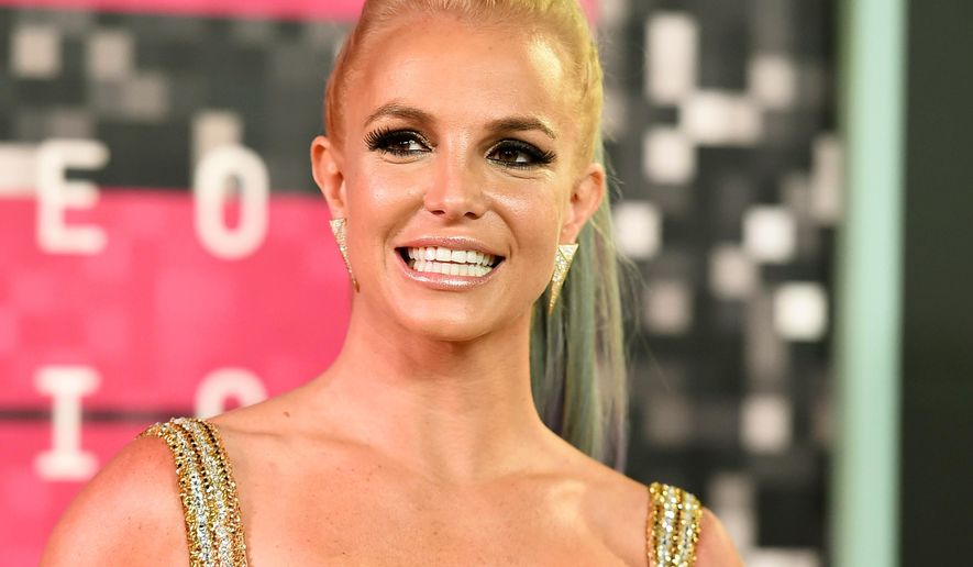 "FILE - In this Aug. 30, 2015 file photo, Britney Spears arrives at the MTV Video Music Awards in Los Angeles. Mobile game maker Glu is launching ""Britney Spears: American Dream"" this week. Spears' game casts players as a budding pop star who must amass a fan base in order to eventually duet with the ""I'm a Slave 4 U"" singer. (Photo by Jordan Strauss/Invision/AP, File)"