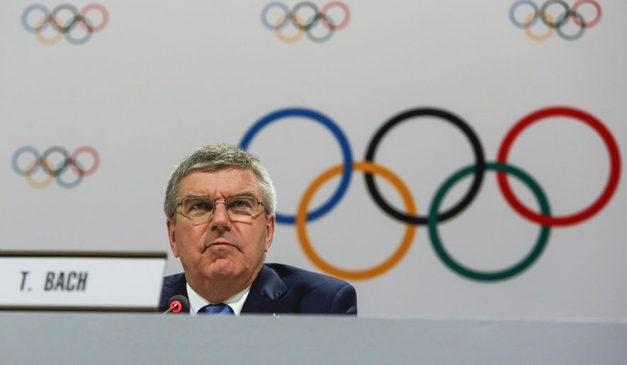 FILE- In this Monday, Aug. 3, 2015 file photo, IOC President Thomas Bach speaks at a press conference after the 128th IOC session in Kuala Lumpur, Malaysia. Bach said Wednesday May 18, 2016 entire sports federations could be suspended if allegations of state-supported Russian doping at the 2014 Sochi Olympics are proven. (AP Photo/Joshua Paul, File)