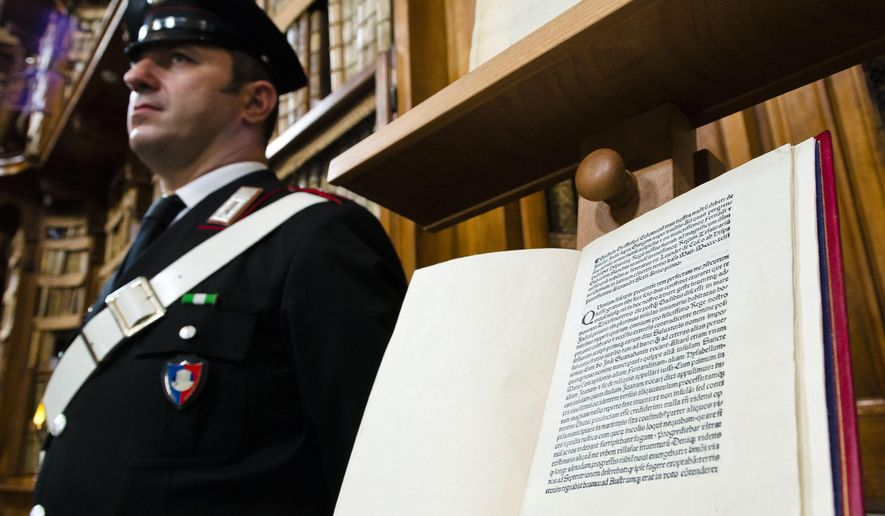 A reprinted copy of Christopher Columbus original letter written in 1493 about the discovery of the New World is displayed during a press conference in Rome, Wednesday, May 18, 2016. The United States has returned to Italy a letter written by Christopher Columbus in 1493 about his discovery of the New World that was stolen from a Florence library and unwittingly acquired by the Library of Congress. (AP Photo/Domenico Stinellis)