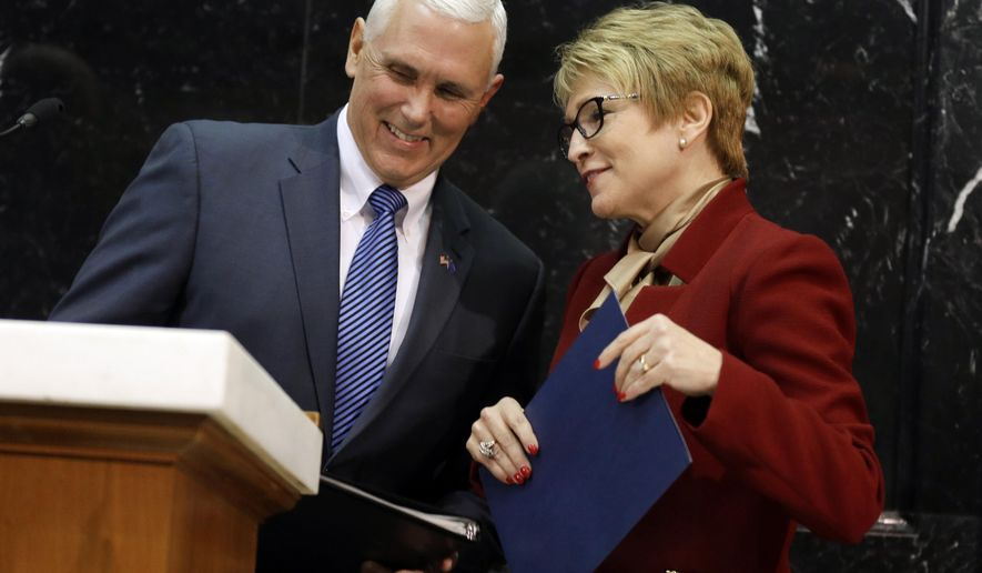 FILE - In this Jan. 13, 2015 file photo, Indiana Gov. Mike Pence speaks with Lt. Gov. Sue Ellspermann before he delivers his State of the State address at the Statehouse in Indianapolis. Ivy Tech Community College's trustees are scheduled to meet Wednesday, May 18, 2016, with a vote expected on a replacement for outgoing President Thomas Snyder. Former Lt. Gov. Ellspermann is widely believed to be the leading candidate for the job. (AP Photo/Michael Conroy File)