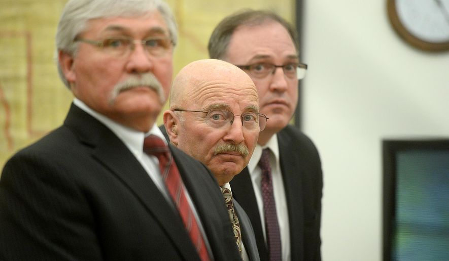 Joseph Campbell, center, flanked by his council, Greg Jackson, left, and Chad Wright, look on just before District Court Judge DeeAnn Cooney ruled on Campbell's change of plea and sentencing, Wednesday morning, May 18, 2016, at the Lewis and Clark County Courthouse in Helena, Mont.  Campbell, who pleaded no contest to negligent homicide in the October 2013 shooting death of his neighbor, was given a 20-year suspended prison sentence in an agreement with prosecutors. (Rion Sanders/The Great Falls Tribune via AP)  NO SALES; MANDATORY CREDIT