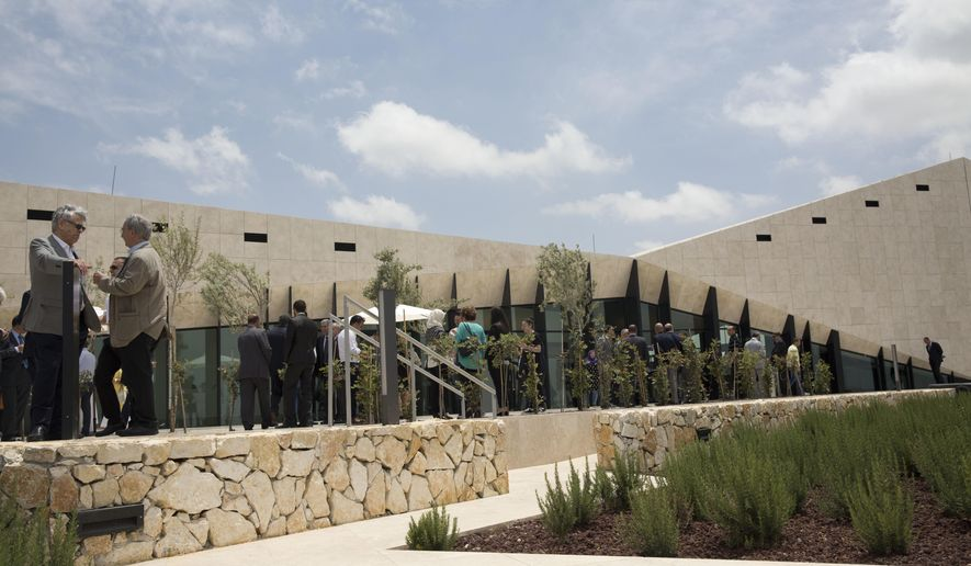 Palestinians visits the Palestinian Museum after it was officially opened to the public in West Bank town of Bir Zeit , Wednesday, May 18, 2016. (AP Photo/Majdi Mohammed)