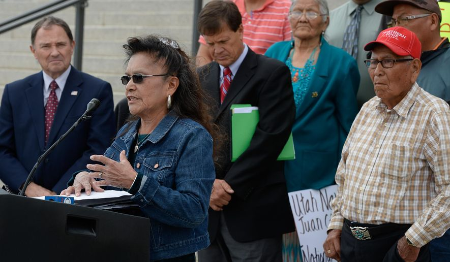 Marie Holiday of the Oljato & Navajo Mountain Community joins Utah lawmakers on the steps of the Capitol during a news conference about a proposed national monument in the Bears Ears area of southeastern Utah at the state Capitol on Tuesday, May 17, 2016, in Salt Lake City. Utah Gov. Gary Herbert said that the proposed national monument would close off the area and block tribal members from using the land.  The news conference came a day before lawmakers were set to gather in a special session to pass a resolution trumpeting their opposition to the proposed monument. (Francisco Kjolseth /The Salt Lake Tribune via AP) DESERET NEWS OUT; LOCAL TELEVISION OUT; MAGS OUT; MANDATORY CREDIT