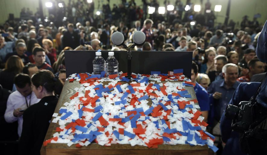 FILE - In this March 15, 2016, file photo, confetti covers a podium after Ohio Gov. John Kasich, winner of the state's Republican presidential primary, spoke at his primary election night rally in Berea, Ohio. In the swing state of Ohio, more than three times as many Democrats cast Republican ballots in the March 15, 2016, presidential primary compared with the number of GOP party switchers, according to data released Wednesday, May 18, 2016, by Ohio Secretary of State Jon Husted's office. (AP Photo/Matt Rourke, File)
