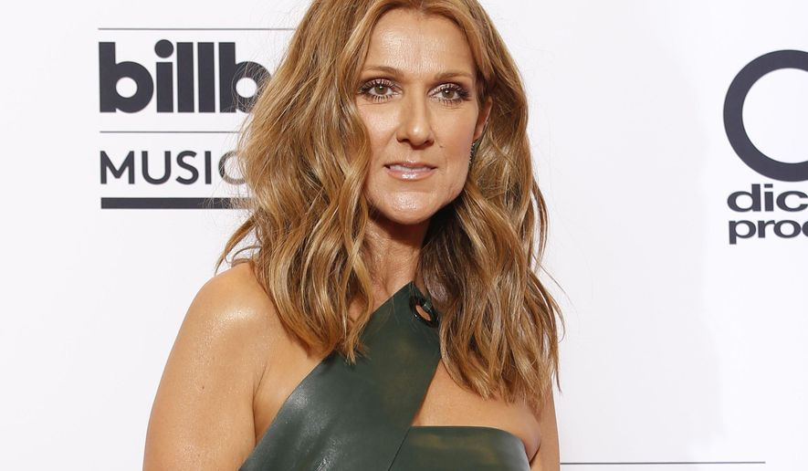 FILE - In this May 17, 2015 file photo, Celine Dion poses at the Billboard Music Awards in Las Vegas. Dion will honor the victims of the attacks in Paris at the American Music Awards on Sunday, Nov. 22, 2015. Dion discussed husband Rene Angelil's death with ABC News in an interview broadcast May 18, 2016. (Photo by Eric Jamison/Invision/AP, File)