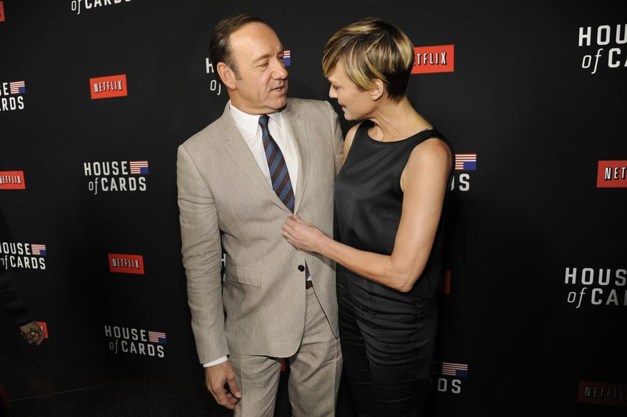 In this Feb. 13, 2014, file photo, Kevin Spacey, left, and Robin Wright arrive at a special screening for season 2 of 'House of Cards' in Los Angeles. (Photo by Chris Pizzello/Invision/AP, File) **FILE**