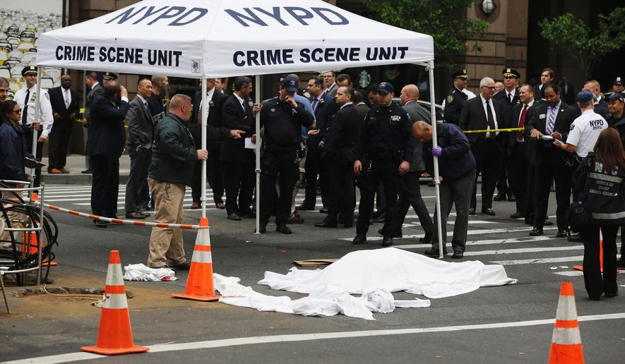 Police work at the scene following a fatal shooting in New York on Wednesday, May 18, 2016. The incident occurred near a few of Broadway's big theaters. (AP Photo/Seth Wenig)